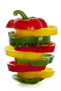 fresh green, yellow and red paprika  isolated on white