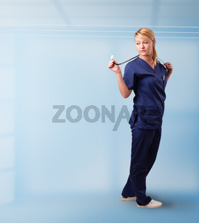 Pretty nurse in hospital listening to empty copy space with sthetoscope