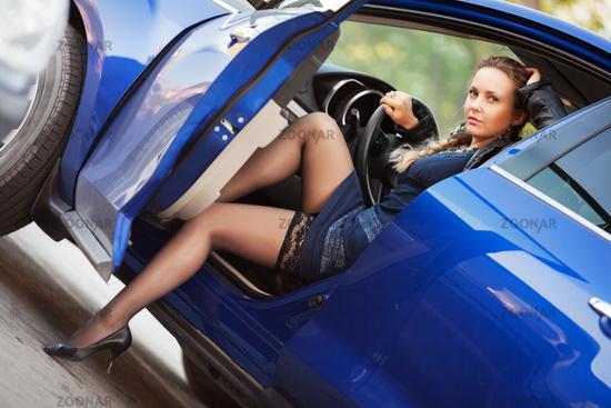 Woman in a sports car
