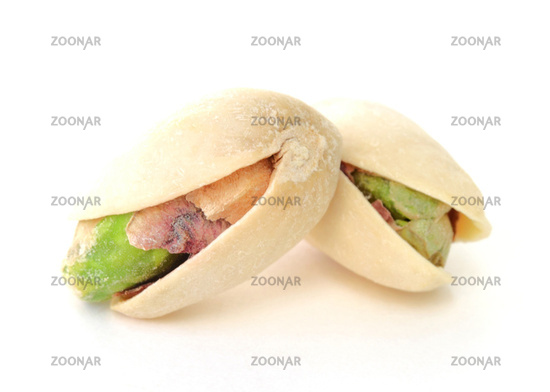 Two pistachios isolated on white background