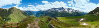 Summer Alps mountain pass panorama.