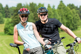 Sport mountain biking couple relax in meadows