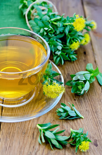 Herbal tea with Rhodiola rosea in the cup on the board