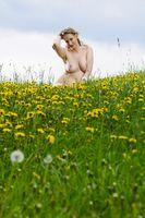 Plus size woman naked in meadow