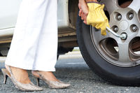 Woman changing car tyre