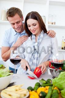 Loving couple preparing dinner