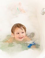 Boy swimming in a bath