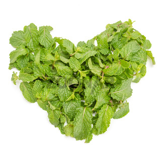 hart from three fresh mint leaves isolated on white background. Studio macro
