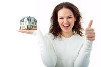 young woman with little house in hand