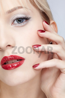 girl with red manicure