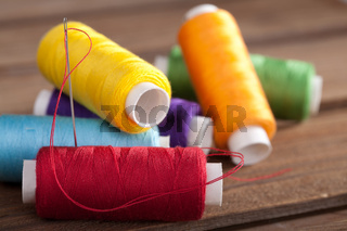 coloured bobbins of thread