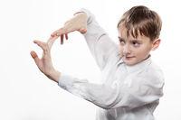 Joyful teenager does blow by fingers