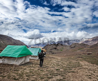 Photographer taking photos in Himalayas mountains with mobile phone. Spiti valley