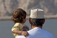 Omani man withd aughter wearing a Kummah, Oman