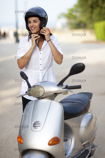 Attractive woman takes off her helmet