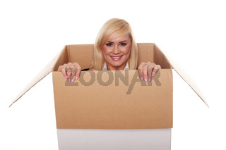 Attractive young blonde emerging from a box