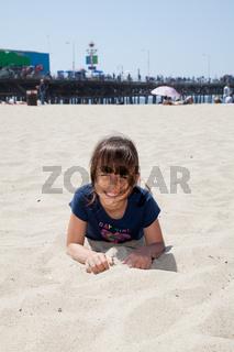 Little Girl Lying on the Beach