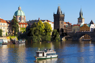 Prague, the Czech Republic - Boat on Vltava near the Charles Bridge