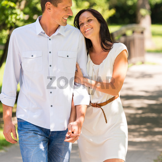 Young happy couple embracing in park