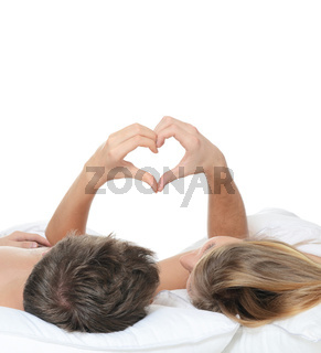 Beautiful pair lays in a bed