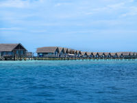 Row of villas on stilts