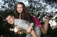young couple piggybacking in park