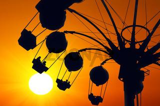 Amusement ride on golden sunset