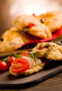 Homemade pizza rolls stuffed with tomato and mozzarella