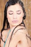 Sensual woman under shower