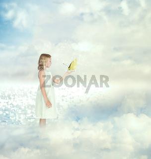 Little girl holding a butterfly