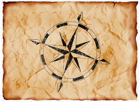 wind rose compass on yellowed paper