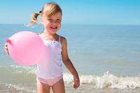 child on coast of sea