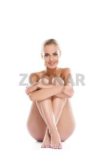 Woman posing implied nude