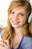 Portrait of a teenage girl listening music