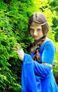 elf princess in green garden
