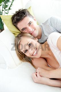 Beautiful lovers having fun together on a sofa