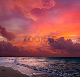 Calm peaceful ocean and beach on tropical sunrise. Bali