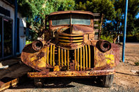 Old rusted truck on the side of the road
