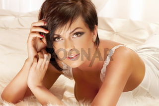 Portrait of sensual brunette looking at camera