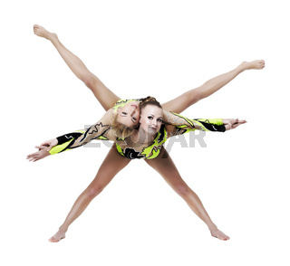 Two young woman show high gymnastic exercise