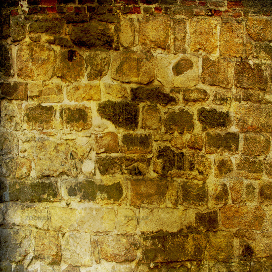 The background of the old masonry with traces of the former might