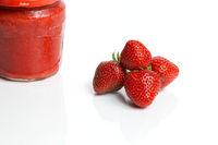 Homemade strawberry jam and strawberries