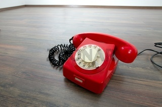 Red telephone on the floor