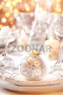 Place setting for Christmas in white and golden tone