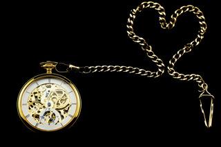 Old watch machine on dark background