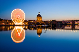 Big ferris wheel in the evening in Toulouse France