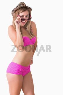 Woman wearing underwear and winking