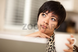 Pretty Mixed Race Woman Holding Cup Using Laptop