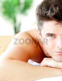 Close-up of an attractive man in a spa center
