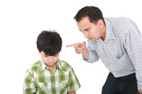 A father is threatening his little boy with a fing